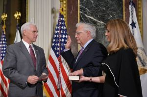 US Vice President Mike Pence administers the swearing-in ceremony for David Friedman as the US ambassador to Israel, as his wife Tammy Sand stands by, in Washington, DC, on March 29, 2017 (AFP Photo/Mandel Ngan)