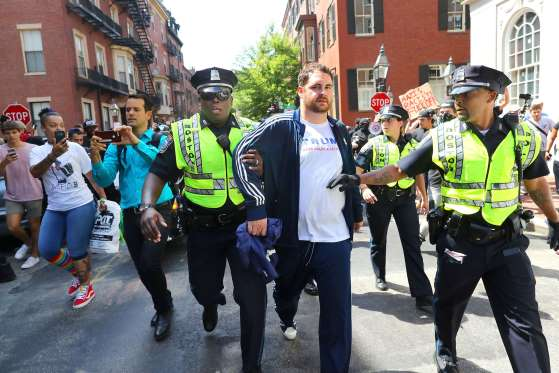A Free Speech advocate has to be escorted by Boston Police as haters threaten his safety when the Boston Free Speech rally is dissolved, Boston on Aug. 19, 2017.