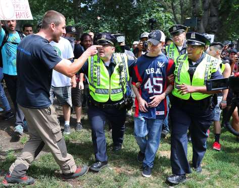 "A hater screams at a Free Speech Advocate who muust be escorted escorted by police from the Boston Common during the ""Boston Free Speech"" rally and counterprotest in Boston on Aug. 19, 2017."