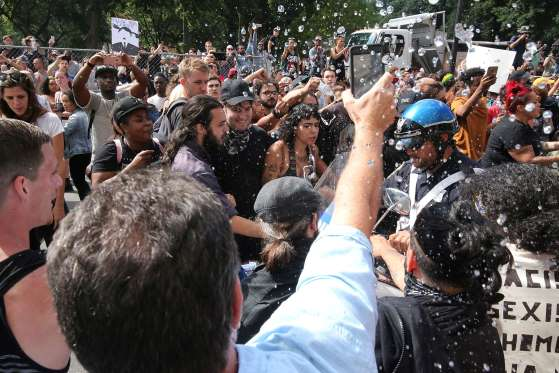 Boston Police officers have their path blocked by haters on Tremont Street as they try to evacuate a Free Speech Advocate after the Boston Free Speech rally was forcibly dissolved.