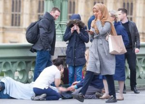 """Moslem woman ignores terrorist attack and checks her phone"" meme"
